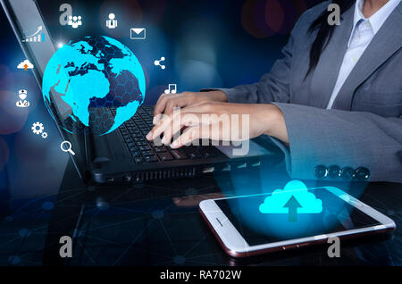 The phone has a cloud icon. Press enter button on the computer. business logistics Communication network World map send message Connect worldwide hand - Stock Photo