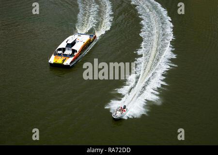 A speedboat and a CityCat ferry on the Brisbane River, Brisbane, Queensland, Australia - Stock Photo
