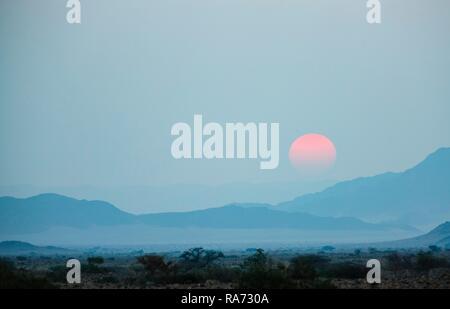 Sunset over the mountains of the Namib Desert, Sesriem, Namibia - Stock Photo