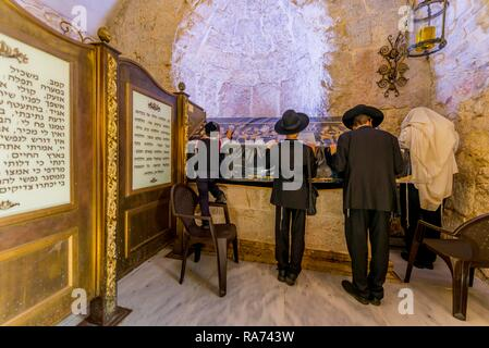 Praying Orthodox Jews in front of the tomb of David, tomb of the biblical king David, city of David, Jerusalem, Israel - Stock Photo