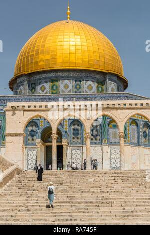 Tourists on a staircase with archway in front of the Dome of the Rock, also Qubbat As-sachra, Kipat Hasela, Temple Mount - Stock Photo