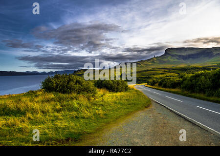 Rock Formation Old Man Storr In Scenic Landscape With Road On The Isle Of Skye In Scotland - Stock Photo