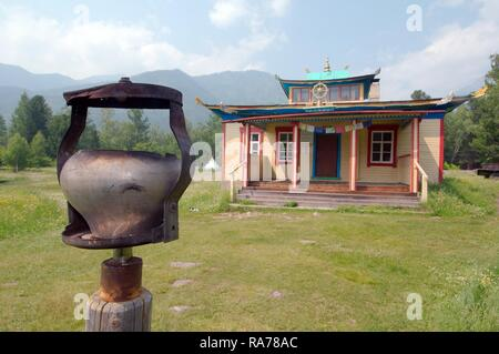 Altar in Datsan, Buddhist university monastery, Arshan, Tunkinsky District, Republic of Buryatia, Siberia, Russian Federation - Stock Photo