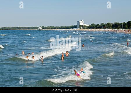 Tourists bathin in the Baltic Sea, Timmendorfer Strand, Schleswig-Holstein, Germany - Stock Photo