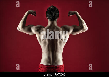Attractive guy muscular back. Proud of excellent shape. Muscular bodybuilder concept. Healthy and strong. Macho handsome with muscular torso. Improve yourself. Man muscular athlete stand confidently. - Stock Photo