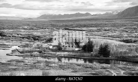 plain thingvellir national park in reykjavik enters to the iceland golden circle. countryside with river, church, houses on mountain landscape in Iceland. best vacations. perfect morning - Stock Photo