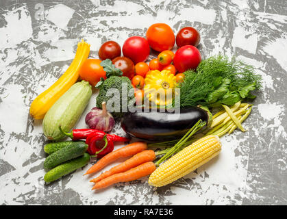 Healthy vegan food. Fresh vegetables on concrete background. Detox diet. Different colorful fresh vegetables . - Stock Photo
