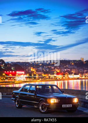 Road trip coast to coast in Ex George Harrison 1984 Mercedes Benz 500SEL AMG - Stock Photo