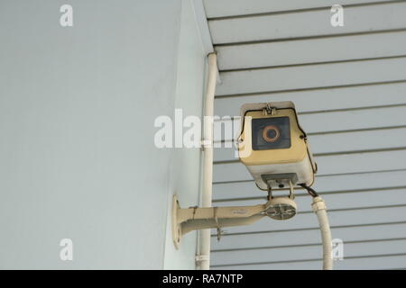closeup of old cctv camera on the wall - Stock Photo