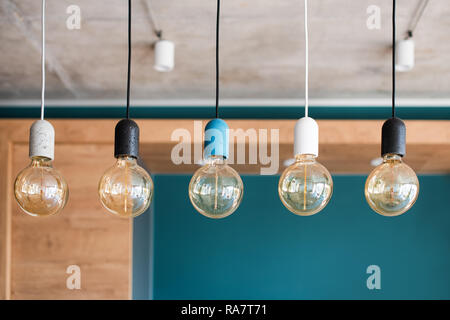 Edison retro lamps. Incandescent bulbs on grey wall background in loft. Concept of vintage style - Stock Photo