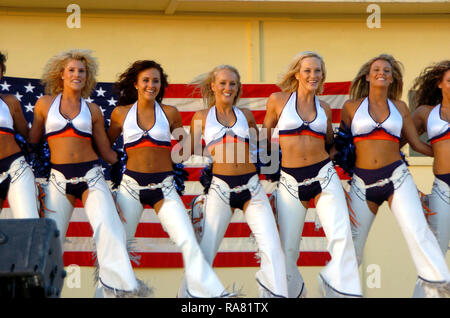 The National Football League's Denver Broncos Cheerleaders are shown performing for Coalition service members at the Kandahar Air Field in Afghanistan on July 3, 2005. - Stock Photo
