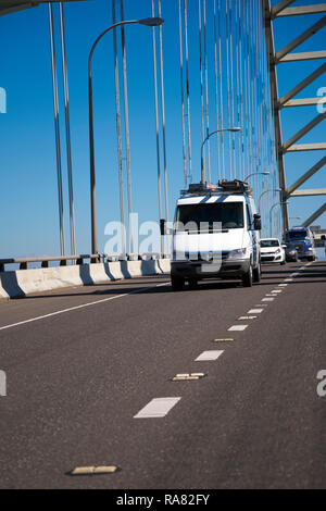 White popular compact comfortable commercial useful economical small business or cargo delivery mini van running on the arched Fremont bridge in Portl - Stock Photo