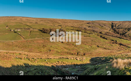 North Pennines AONB panoramic landscape, view over the Hudes Hope valley, Teesdale, UK in strong winter sunshine and a clear blue sky - Stock Photo