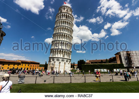 pisa, Italy - May, 17, 2017: Tourist admiring the Leaning tower of Pisa up close at the base. - Stock Photo