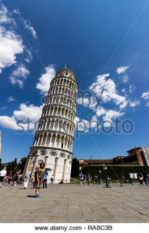 pisa, Italy - May, 17, 2017: Tourist walking around the base of the Leaning tower of Pisa. - Stock Photo