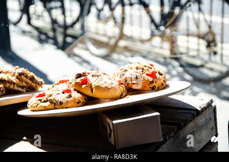 Delicious cookies on a plate in store front - Stock Photo