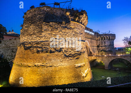 Porta Nuova (or Porta Salis) by night with the two Renaissance circular towers built in the XV-XVI century, is one of the gates to the medieval villag - Stock Photo