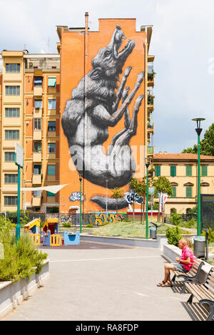 Jumping Wolf wall mural by the Belgian street artist Roa in Testaccio, Rome, Italy. - Stock Photo