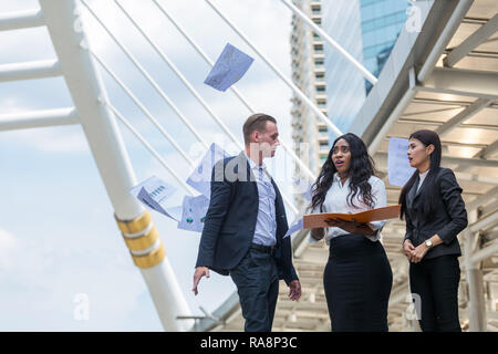 angry manager push away report from office girl - Stock Photo
