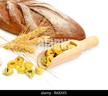 Bread and wheat ears isolated on white background - Stock Photo