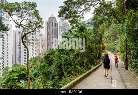 Old Peak Road, now a walking path between the Mid-Levels and Victoria Peak in Hong Kong - Stock Photo