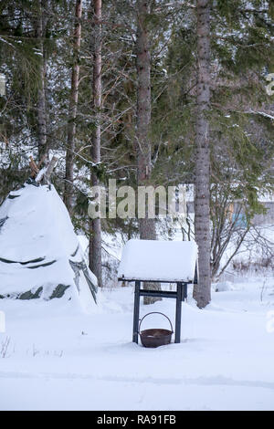 Well covered in snow - Stock Photo