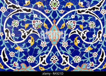 Detail of floral ceramic decoration. Eastern architectural colored pattern. Tiled background with islamic ornament. Mosaic blue tiles. Malaysia. - Stock Photo
