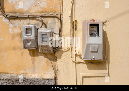 GREECE - CORFU - BENITSES - JULY 27, 2018: Electricity meters on a wall in Benitses on Corfu in Greece. - Stock Photo
