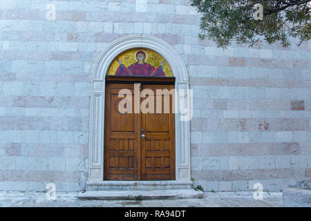 Door of the Holy Trinity church in the old town of Budva, Montenegro - Stock Photo
