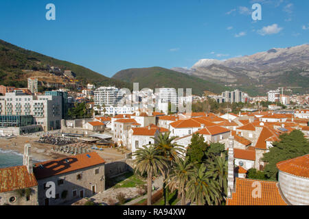 Landscape of of Mediterranean old town Budva, Montenegro. Ancient walls and red tiled roofs - Stock Photo