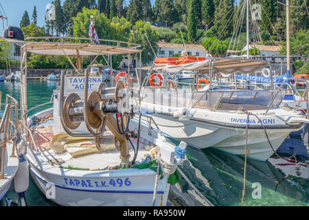 GREECE - CORFU - KOULOURA - JULY 25, 2018: Fishing boat and other boats in the port of Kouloura in Corfu, Greece. - Stock Photo