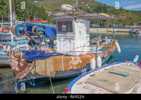 GREECE - CORFU - KOULOURA - JULY 29, 2018: Fishing boat for a fishingtrip and other boats in the port of Kouloura in Corfu, Greece. - Stock Photo