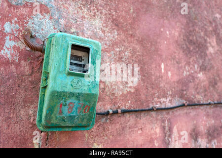 GREECE - CORFU - SINARADES - AUGUST 2, 2018: Electricity meter on a wall in Sinarades on Corfu in Greece. - Stock Photo
