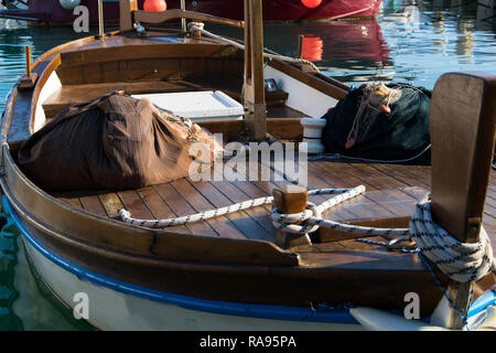 Traditional wooden fishing boat in  marina harbor of Mediterranean city Budva, Montenegro. Fishing industry/tourism - Stock Photo