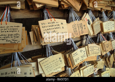 Messages of hope and prayer at the Meiji Jungu Shinto shrine in Tokyo. Japan. - Stock Photo