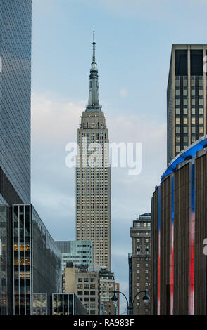 the Empire State Building shoot late afternoon from the street view - Stock Photo
