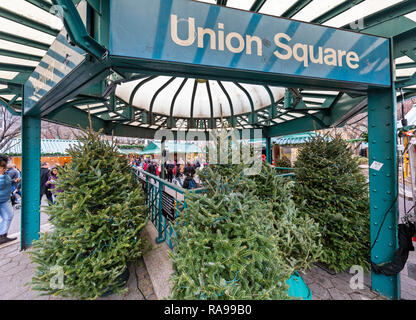 Shoppers and tourists exploring the Union Square Holiday Market in Union Square, New York City. - Stock Photo