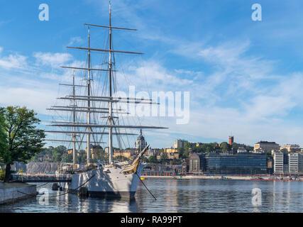 The af Chapman full rigged sailing vessel, now a youth hostel, Skeppsholmen looking towards Stadsholmen, Stockholm, Sweden - Stock Photo