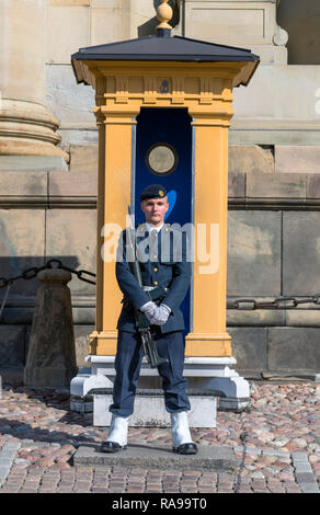 Mamber of the Swedish Royal Guards (Högvakten) outside the Royal Palace (Kungliga slottet) in Gamla Stan (Old Town), Stockholm, Sweden - Stock Photo