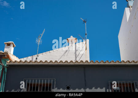 TV aerials on the roof of a building in Denia, Spain. - Stock Photo