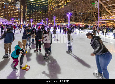 Ice Skaters at Ice skating rink at the Bryant Park Holiday Market in Bryant Park, New York City. - Stock Photo