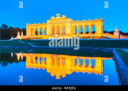 VIENNA - AUGUST 29: Gloriette Schonbrunn at sunset with tourists on August 29, 2017 in Vienna. It's the largest gloriette in Vienna built in 1775 as t - Stock Photo