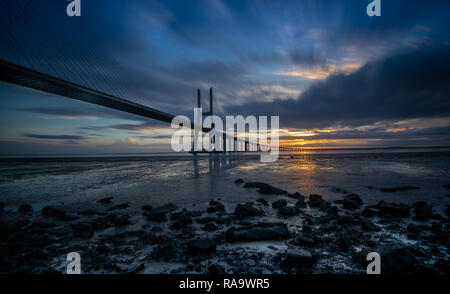 The Vasco da gama bridge in Lisbon during sunrise. It is the longest bridge in Europe. It measures over 10 miles (17 km) long and connects the norther - Stock Photo