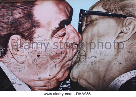 Berlin Wall, Berliner Mauer, East-Side Gallery, Brezhnev and Honecker kiss - Stock Photo