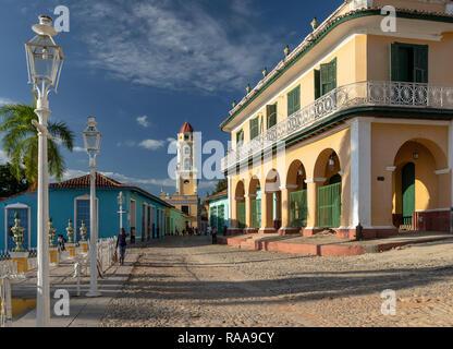 Palacio Brunet and San Francisco tower in late afternoon light at Plaza Mayor, Trinidad, Cuba - Stock Photo