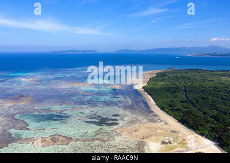 Aerial view of spectacular white coral sand beach and clear turquoise waters on Taketomi Island, Yaeyama, Okinawa, Japan, taken by drone