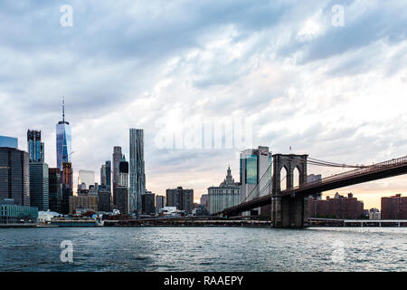 The Manhattan skyline and Brooklyn Bridge at sunset viewed across the East River from Brooklyn Heights Esplanade, New York City, NY, USA - Stock Photo