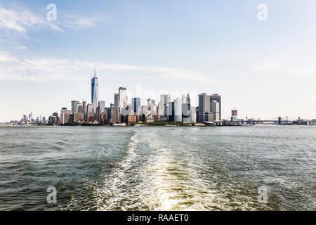 Panoramic view on the Financial District skyscrapers with One World Trade Center from the Staten Island Ferry. Lower Manhattan, New York City Harbor