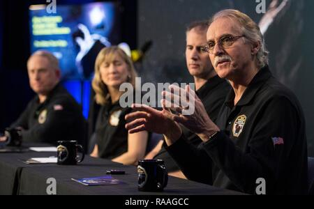 New Horizons co-investigator John Spencer, right, of the Southwest Research Institute during a briefing prior to the expected flyby of Ultima Thule by the New Horizon spacecraft at Johns Hopkins University Applied Physics Laboratory December 31, 2018 in Laurel, Maryland. The flyby by the space probe occurred 6.5bn km (4bn miles) away, making it the most distant ever exploration of an object in our Solar System. - Stock Photo