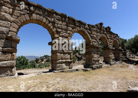 Roman Aqueduct with four preserved arches, ancient city of Alinda, Caria, Anatolia, Turkey. This section of the aqueduct is 45 metres long and above t - Stock Photo
